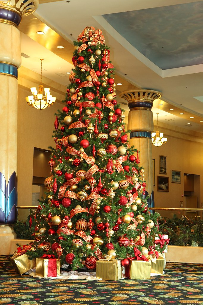 red and gold christmas tree by christmas specialists