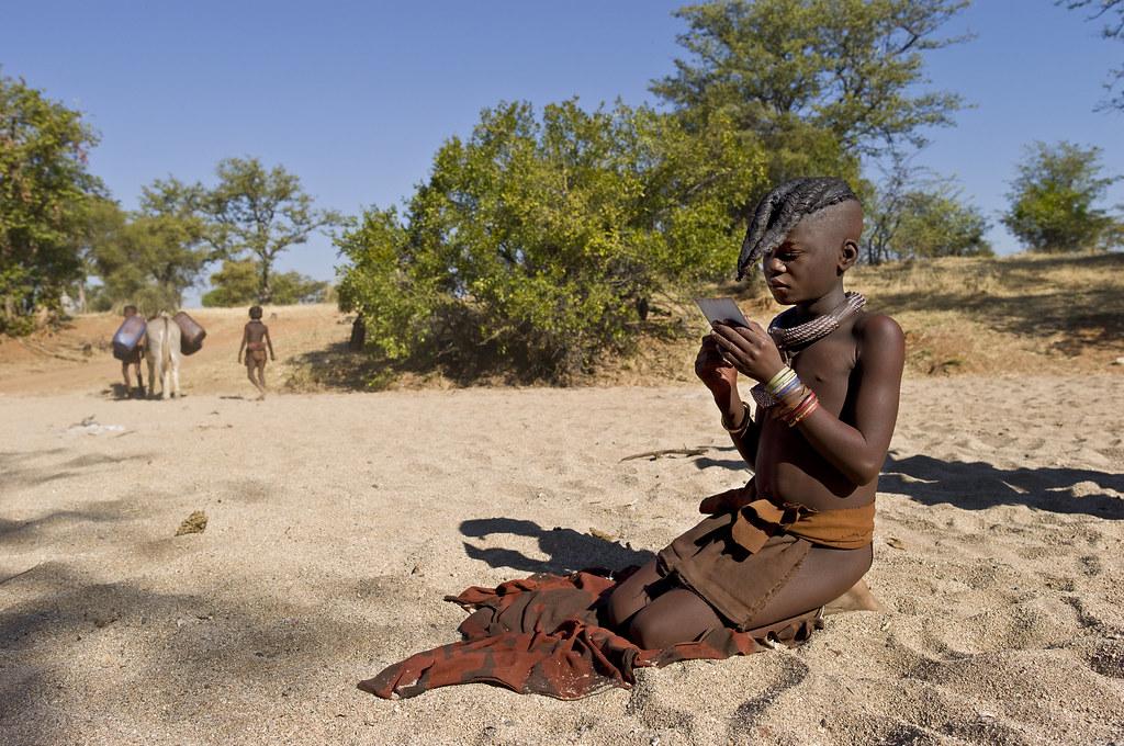 Muchimba Girl Looks At A Polaroid Moimba Angola Himba