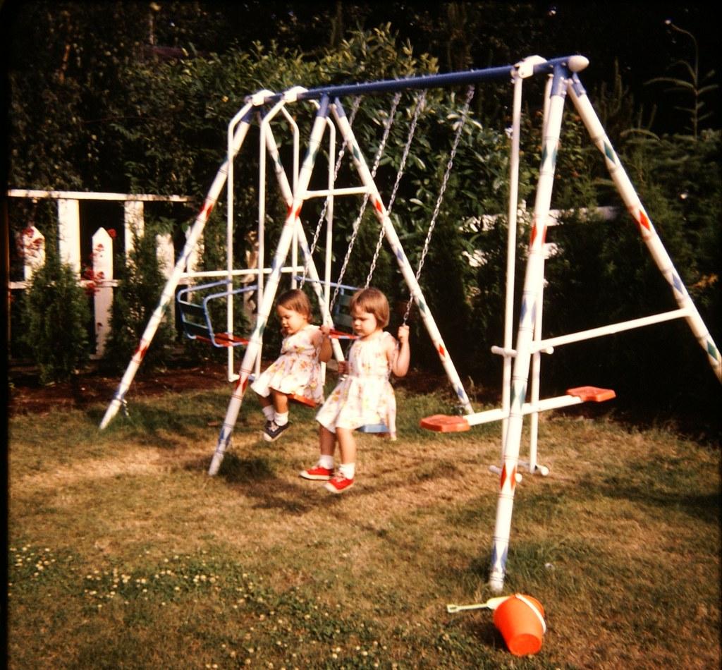 Kids in metal Swingset - 1970's | Mike Leavenworth | Flickr