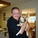 kai holds zuko the shiba in their vacation house