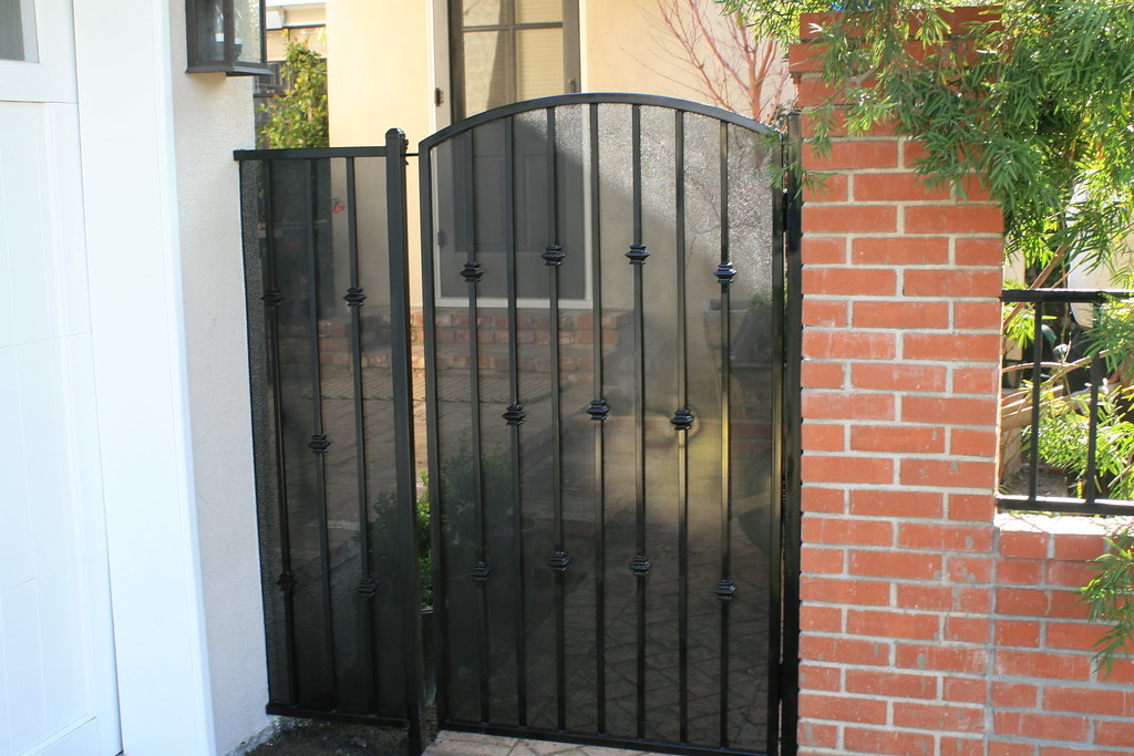 ornate wrought iron gate cast iron ornamental wrought iron gates by dynamic fence arched top gate with perforau2026 flickr
