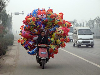 colourful animal balloons have to get to market somehow | by travelling two