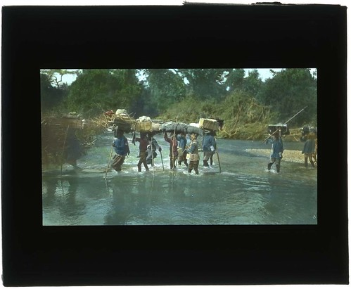 Porters carrying luggage. | by Smithsonian Institution