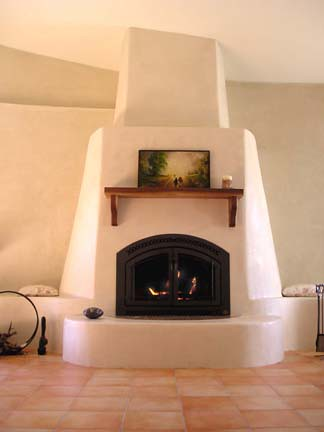 Fireplace covered with American Clay Plaster over StrawBal ...