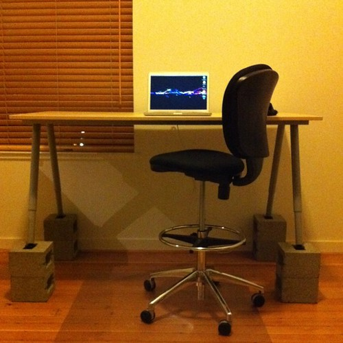 Standing desk from Ikea Galant and concrete blocks + Safco drafting stool | by Matt Sparks