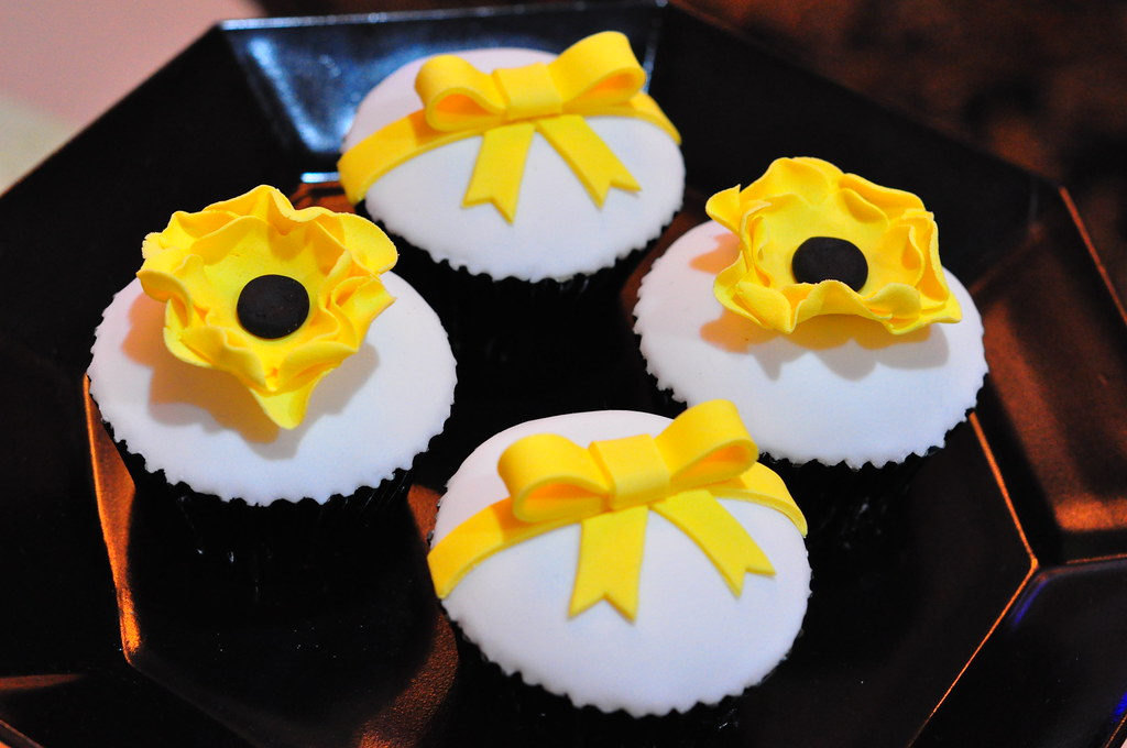 Bright yellow, black and white wedding cupcakes | White choc… | Flickr