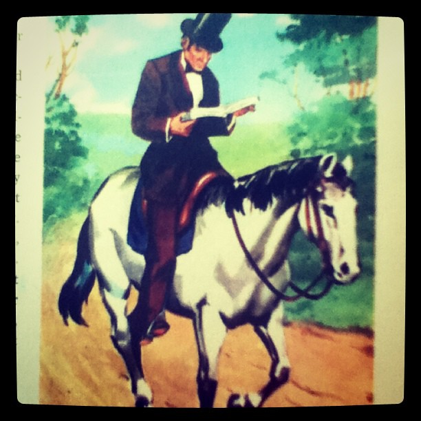 Abraham Lincoln Riding A Horse Reading A Book