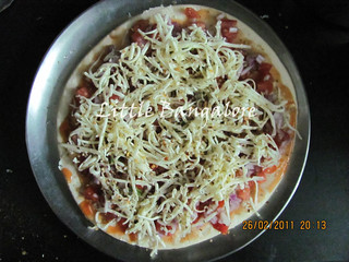Grated cheese on pizza base | by Little Bangalore