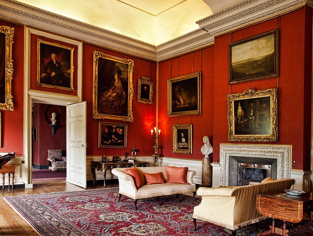 The Red Room of Petworth House which contains paintings by