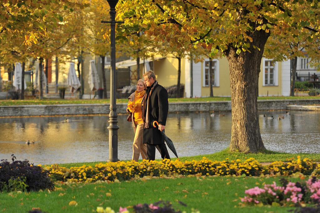 a couple walking in a park photo by mari kadanik flickr