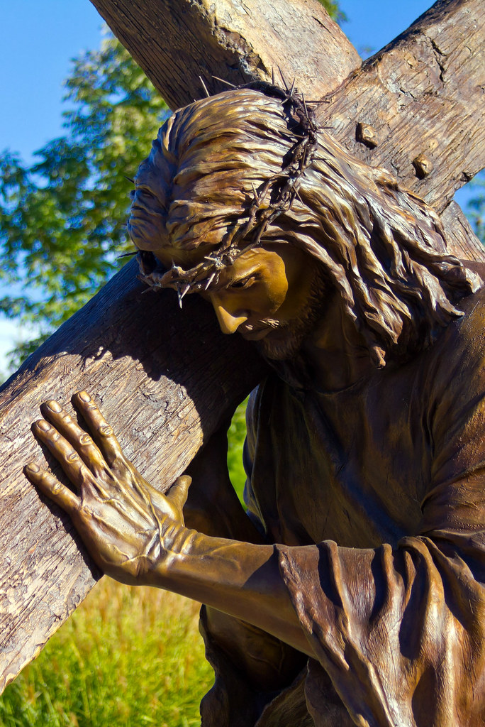 jesus carrying the cross because of love sculpture part flickr