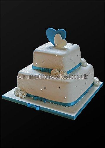 Small Wedding Cake And Cupcakes