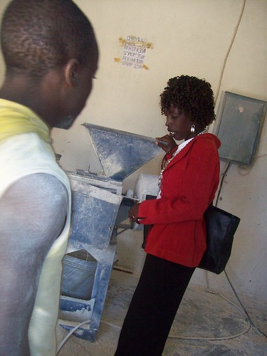 Rebecca Mwanza inspects a hammer-mill. Credit: Lewis Mwanangombe/IPS | by IPS Inter Press Service
