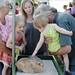 Two girls pet the rabbit at the Grandville Branch's Summer Carnival.