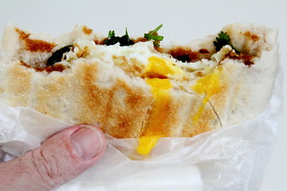 Pancake with fried egg (biteaway view) from He Nan Flavor, Forsyth Street, New York | by Eating In Translation