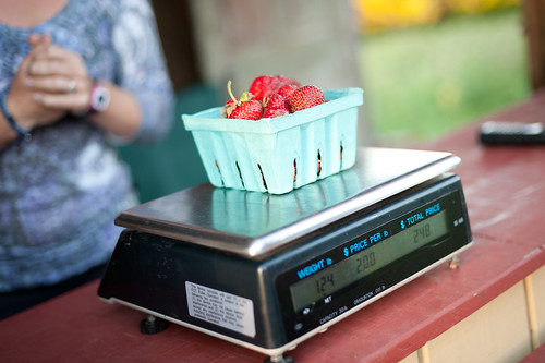Weighing Strawberries | by goingslowly