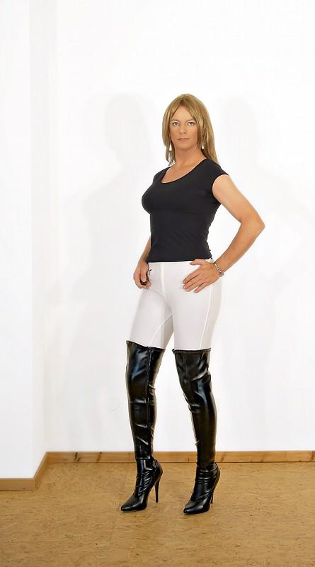 White jodhpurs and black high-heels.