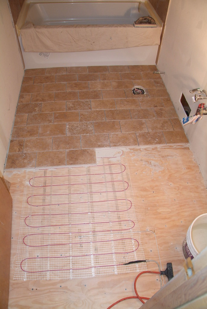 Heated travertine floor vickys 39 bath project riner frost flickr for Installing heated floor in bathroom