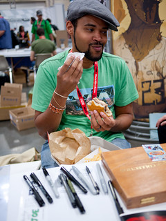 """Chew"" artists Rob Guillory eating a burger 
