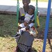 A mother and child test out swing set