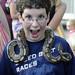 A boy made friends with a snake.