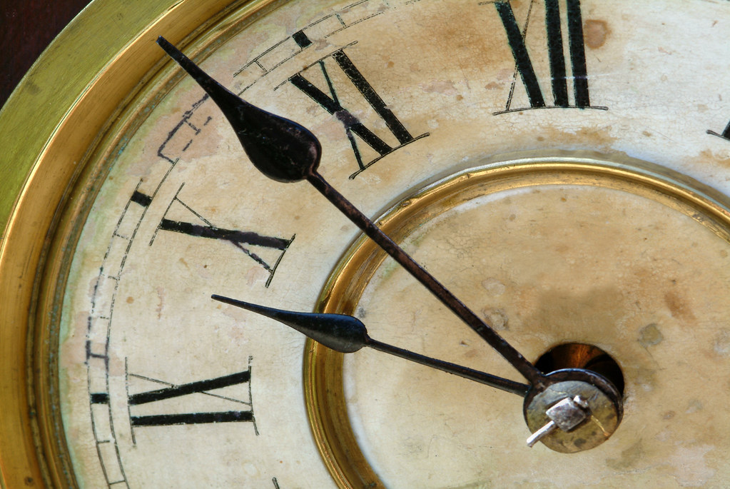 Old Fashioned Clock Face With Moving Hands