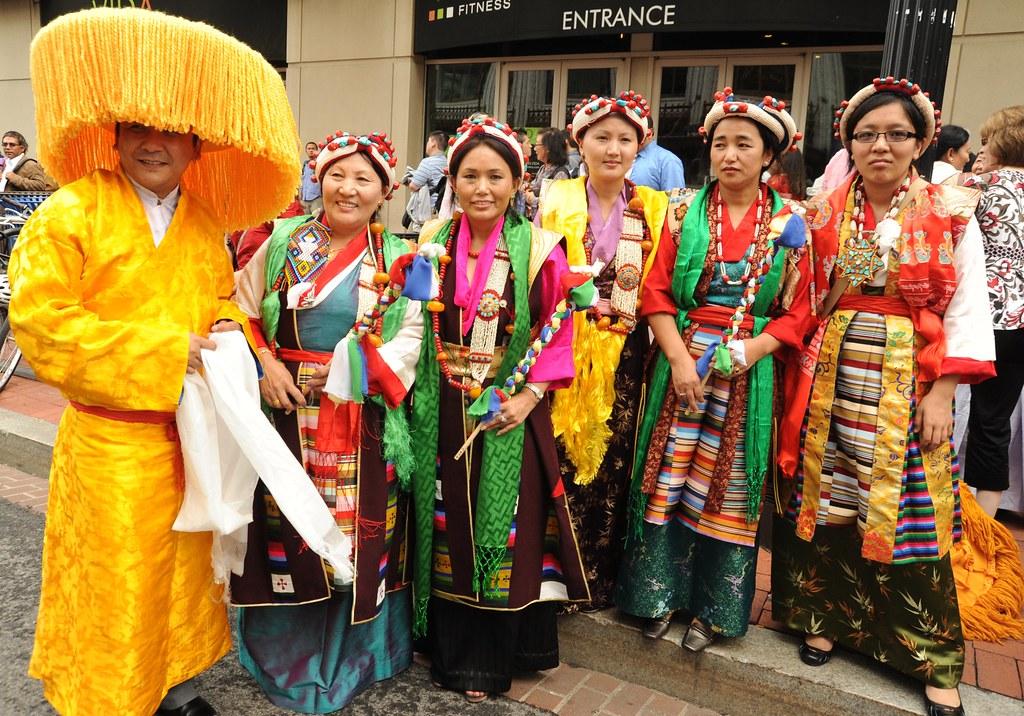 Wearing fabulous orange hat & traditional clothes Tibetan ...