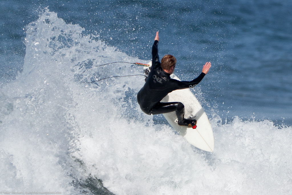 Male Surfer Does A Top Turn At Morro Rock Scenes From A W