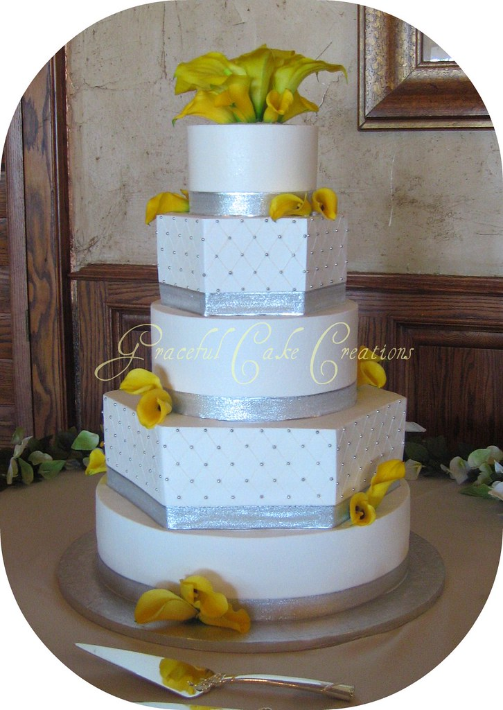 Elegant White and Silver Wedding Cake with Yellow Calla Li ...