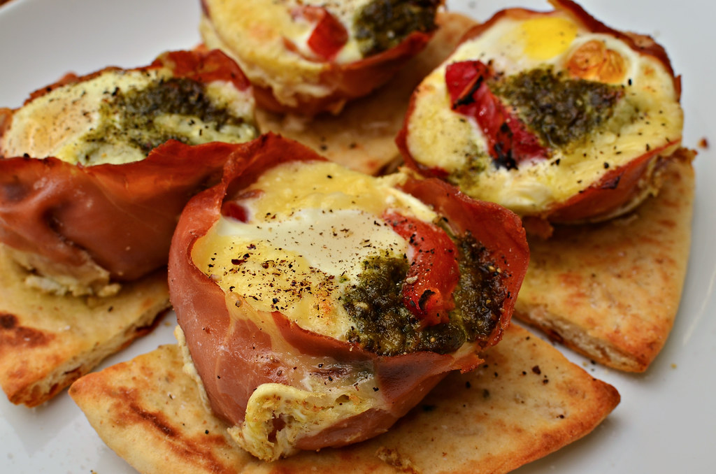 Mmm... prosciutto wrapped baked eggs with pesto, asiago, a… | Flickr
