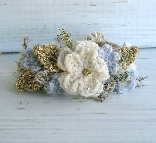 Crochet Bracelet with sparkly white and blue flowers | by meekssandygirl