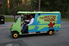 the mystery machine golf cart in the parade by curb crusher