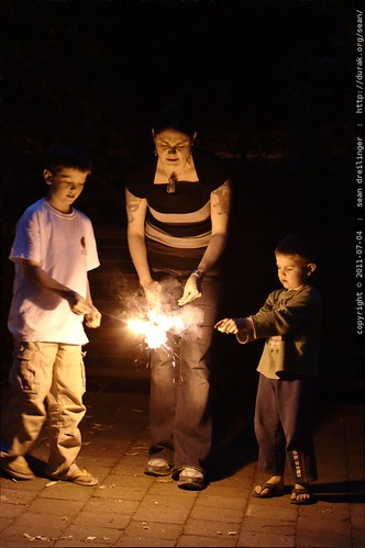 mother and sons lighting sparklers - MG 4881.JPG | by sean dreilinger