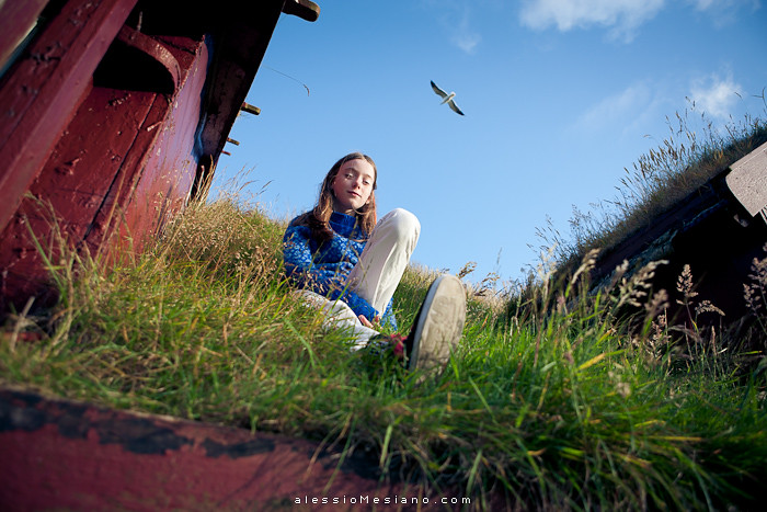 Faroese Girl A Faroese Girl Sitting On A Green Roof Of A