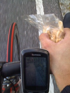 Eating animal crackers on the last climb. Some power stats from the current climb and the current temperature - I was pouring sweat with my jacket and jersey completely unzipped and no gloves on. | by kartoone76