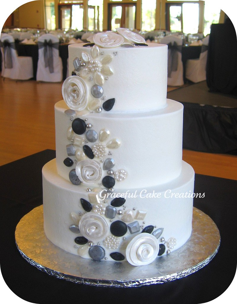 White Wedding Cake With Silver Black And Pearl Jewels Acc