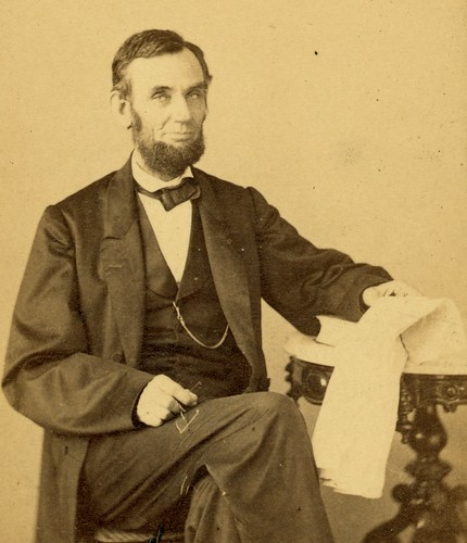 Lincoln with a newspaper