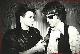https://c1.staticflickr.com/7/6045/6234554597_2ff467c813.jpg Bono 1983