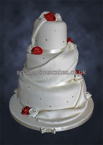 Wedding Cake With Red Roses And Ribbon