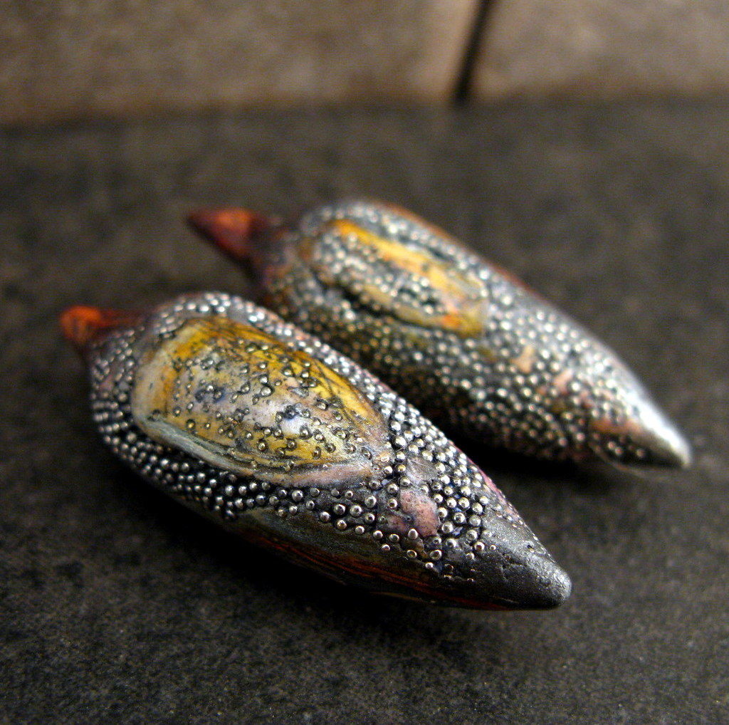 Pods with carving and microballs claire maunsell flickr