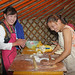 Two women making dumplings at the Naadam Festival