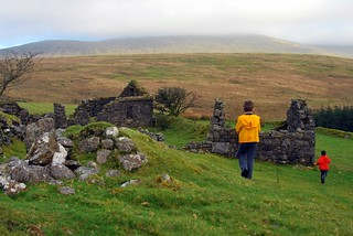 The boys exploring an old ruined cottage in the Comeraghs | by Anne Howard