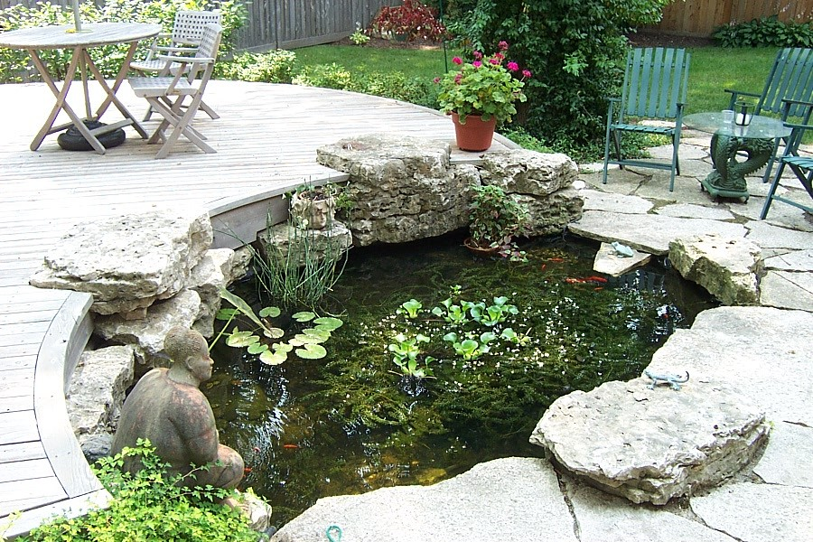 Koi pond in middle of deck and patio koi pond as focal for Balcony koi pond