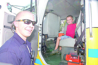 Volunteer Parker Ramsey gave Gaven Moracco and opportunity to see what it felt like to ride in the fire engine. | by VillageNewsOnline