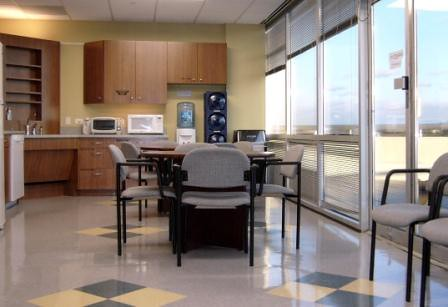 Teak Wood Cabinets, ADA Corner Sink, Accent Floor Tiles