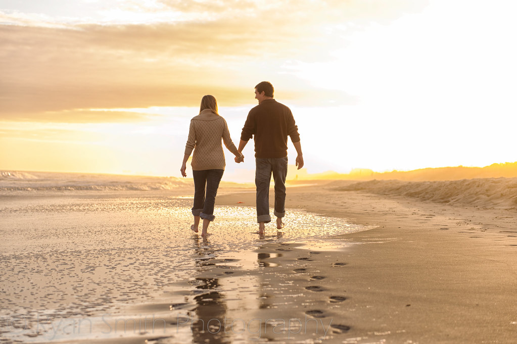 Couple walking together into the sunset - Myrtle Beach State Park