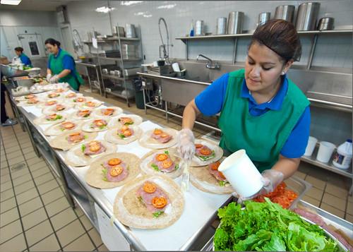 A school food professional preparing school meals