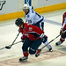Backstrom Challenges Moore For Puck