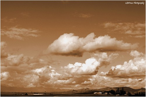 sepia skyline with cottonwool clouds