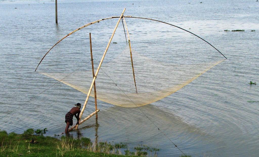 Fishing with dharma jal (lift net), Sunamganj, Bangladesh ...
